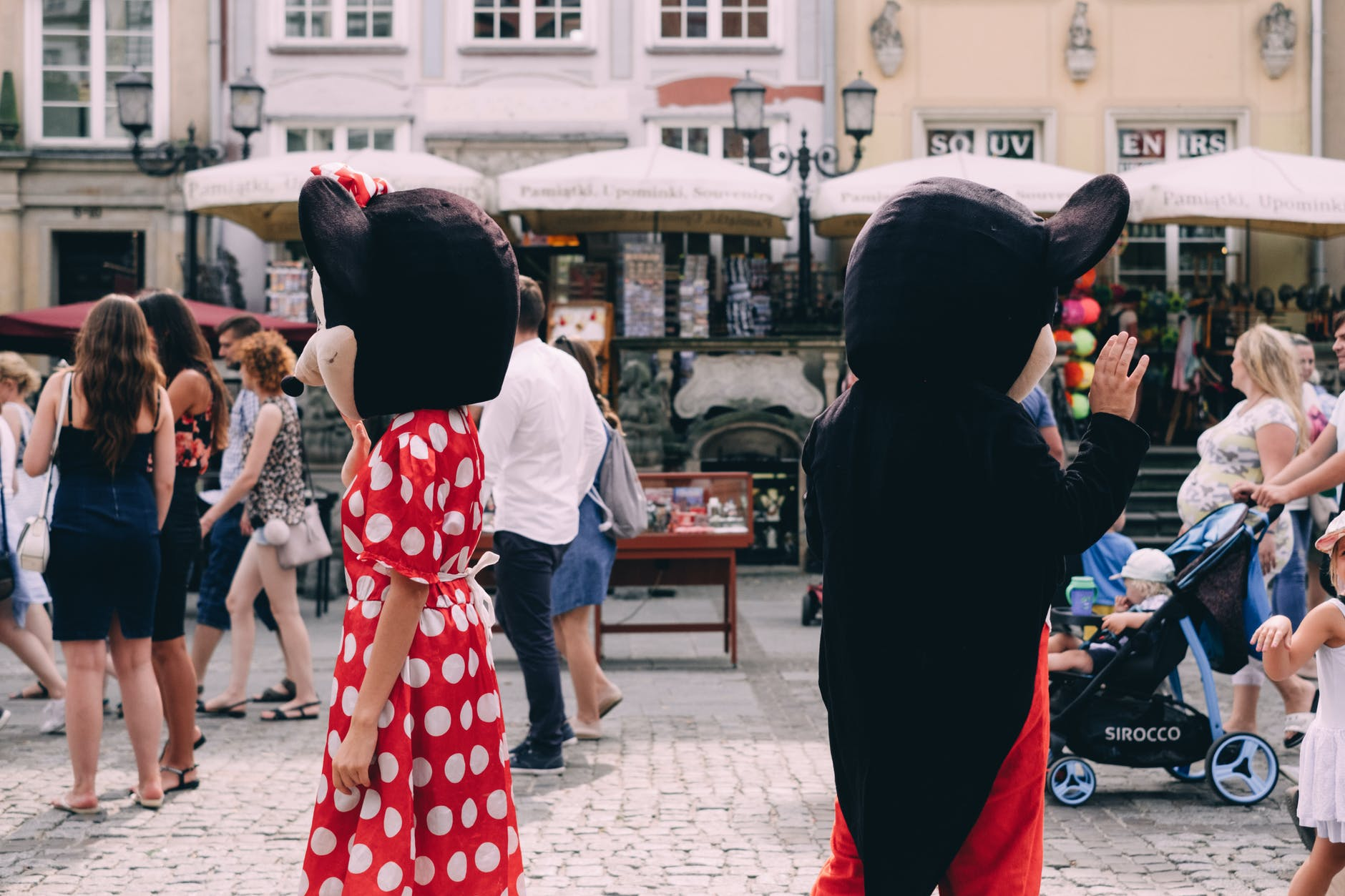 two people wearing mickey and minnie mouse costumes